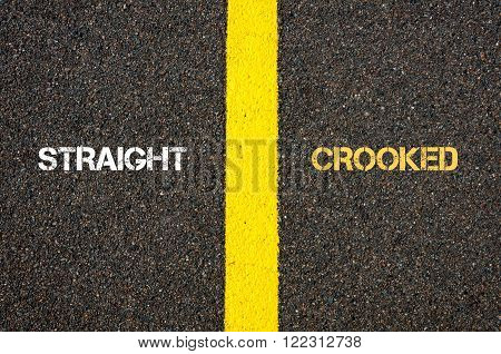 Antonym concept of STRAIGHT versus CROOKED written over tarmac, road marking yellow paint separating line between words