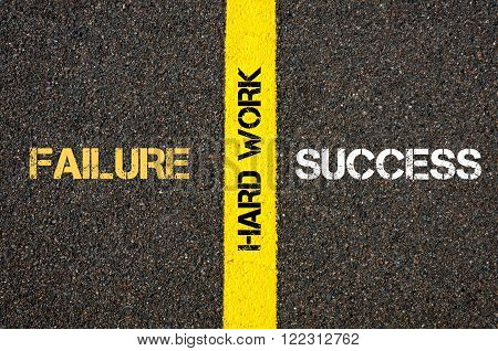 Antonym concept of SUCCESS versus FAILURE written over tarmac, road marking yellow paint separating line with message HARD WORK