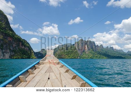 Beautiful mountains behind fog in Ratchaprapha Dam at Khao Sok National Park Surat Thani Province Thailand