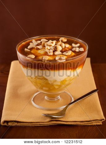 apple  dessert  with whipped cream,caramel sauce and nut served in glasses