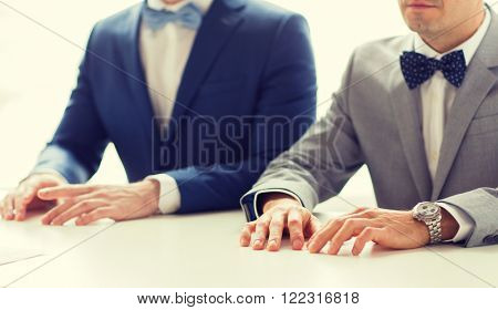 people, homosexuality, same-sex marriage and love concept - close up of happy male gay couple hands on wedding