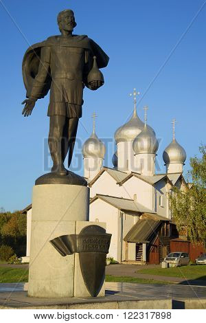 VELIKIY NOVGOROD, RUSSIA - OCTOBER 03, 2015: The monument to St. Alexander Nevsky from the Church of Boris and Gleb autumn evening