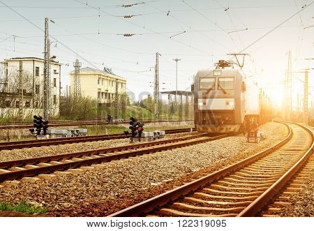 Sun shining, the train slowly approaching from a distance