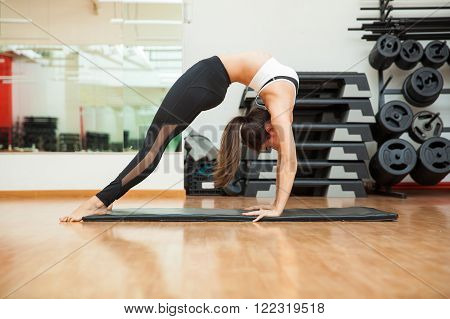 Young Woman Arching Her Back At A Gym
