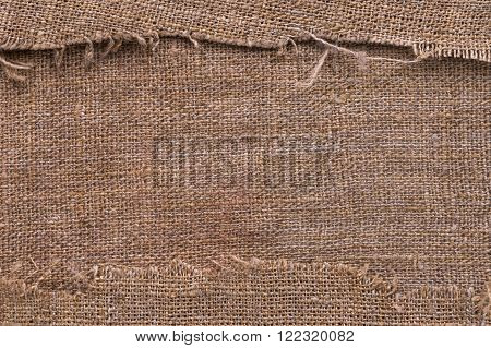 Natural burlap texture with torn edges with space for text top view