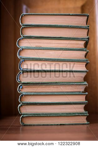 piles of books on table in library hall