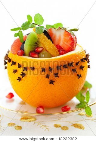 Fruit salad in  hollowed-out oranges studded with cloves   for Christmas