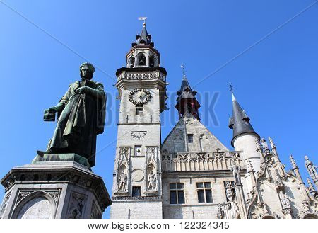 The historic belfry and statue of Dirk Martens on the main market square in Aalst, a town in East Flanders, Belgium.
