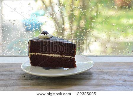 chocolate cake on dish enjoy for rainy day