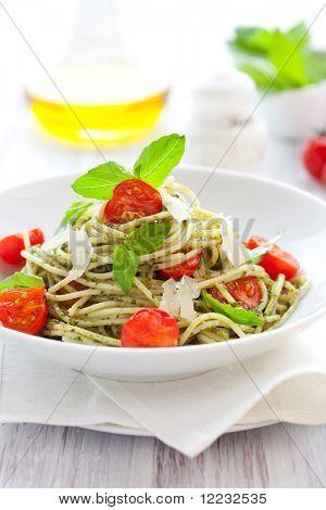 spaghetti with  pesto sauce,cherry tomato and cheese