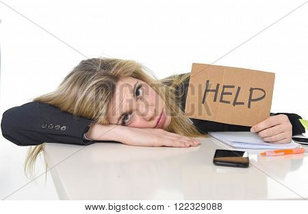 young beautiful business woman suffering stress working leaning sad on office desk asking for help feeling tired and desperate looking overworked overwhelmed and frustrated