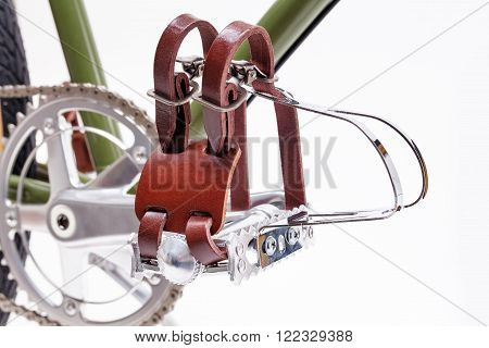 Vintage road bicycle pedals with toe clips isolated on white.