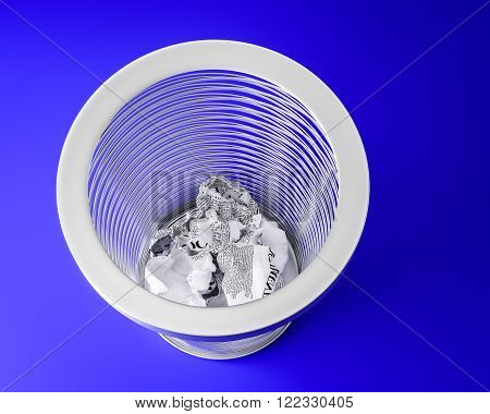 a metal trashcan on a blue background