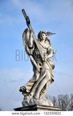 Angel With The Cross. Statue On The Ponte Sant' Angelo Bridge, Rome