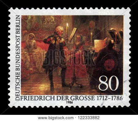 GERMANY- CIRCA 1986: stamp printed by Germany, shows the flute concerto with Frederick the Great, painting by Adolph von Menzel, circa 1986