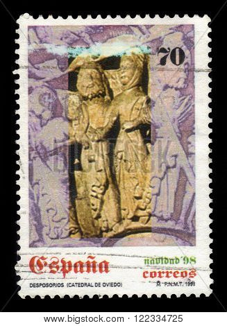 SPAIN - CIRCA 1998: a stamp printed in Spain shows wedding of Mary and Joseph, detail of capital from Oviedo cathedral, circa 1998