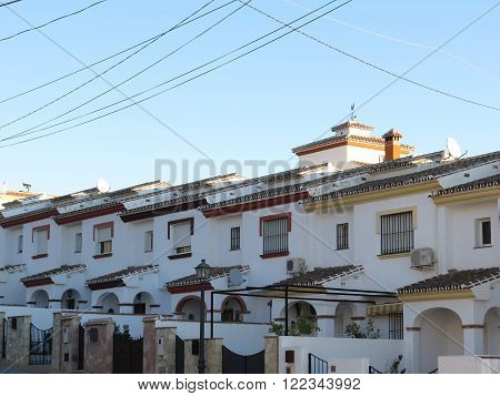 Row of terraced houses on hill in Alora Andalucia