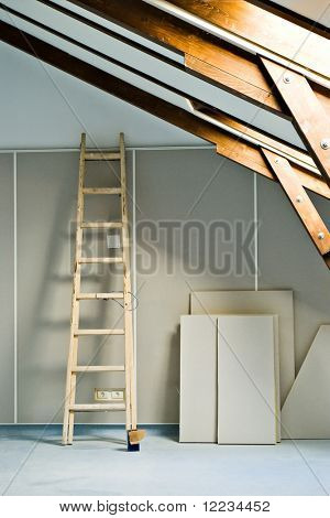 step ladder and construction materials in attic room