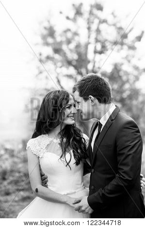 Happy Newlywed Couple Hugging & Smiling In Park B&w