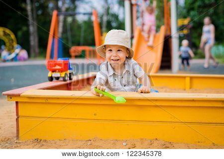 child having fun playing in the sandbox