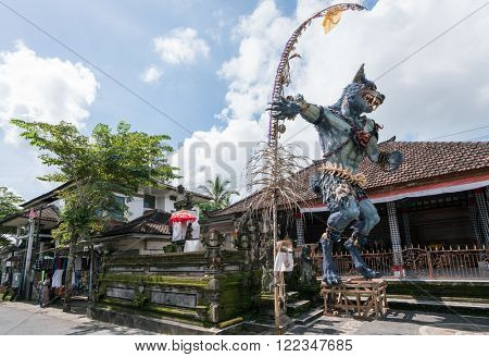 UBUD, BALI - MARCH 14, 2016: A statue of a demon from Balinese Hindu mythology is placed outside a restaurant as an tourist attraction. Tourism is a major industry on Bali Island.