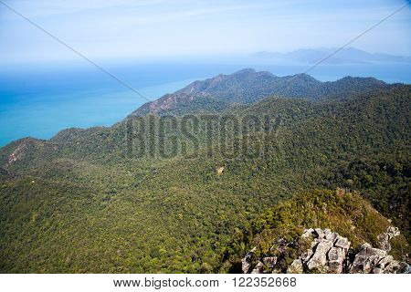 The top of Mount Gunung Mat Cincang in Langkawi, Malaysia, the second highest mountain on the island. A real tropical island view north over the Andaman Sea and Koh Tarutao in Thailand.