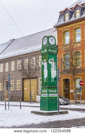 MUEHLHAUSEN GERMANY - JAN 17 2016: old clocktower with advertising for washing powder in snow in Muehlhausen Germany. The ads are more than 100 years old and symbolize the years at beginning of last century.