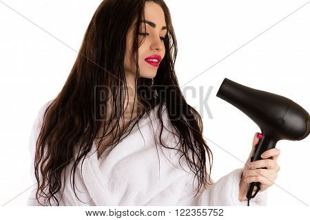 beautiful woman dries the hair dryer isolated on white background