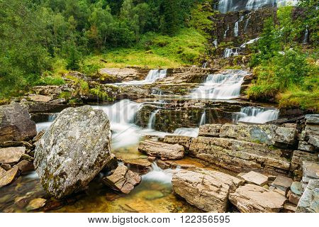 Tvindefossen Waterfall in Norway. Norwegian nature landscape at summer. Waterfall Tvindefossen is largest and highest waterfall of Norway, its height is 152 m.