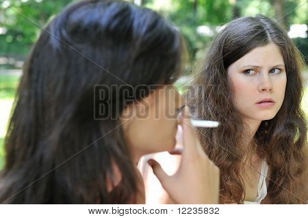 Young People Outdoors - Annoying By Smoking Cigarette