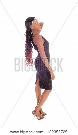 A lovely African American woman standing in profile in a gray dress