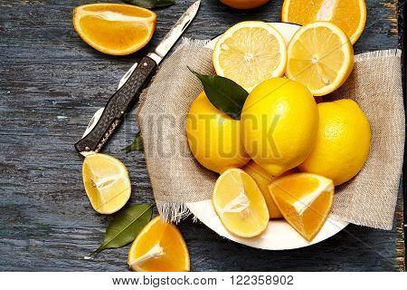 lemons and oranges in an old plate
