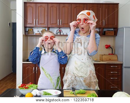 little girl is having fun with her mother at kitchen