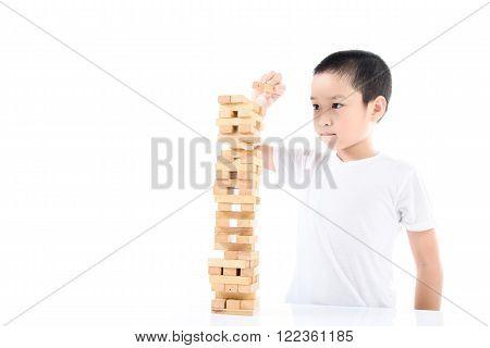 Boy Play Wooden Block Tower