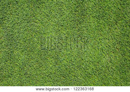 Green Artificial turf soccer field as texture background