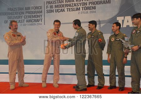 ANKARA/TURKEY-SEPTEMBER 2: TAI Test Pilots Murat Keles (L) and  Ercan Celik (2nd left) with Pakistan Air Force Pilots during the