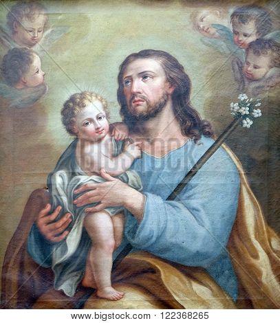 BOLOGNA, ITALY - JUNE 04: Saint Joseph holding baby Jesus, altarpiece in San Petronio Basilica in Bologna, Italy, on June 04, 2015.