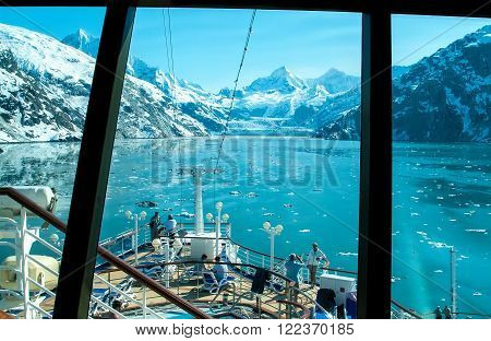 GLACIER BAY, AK - JUNE 1, 2009: View through a cruise ship window of a glacier in Glacier Bay. Passengers take in the scenic view before cruise ship departs.
