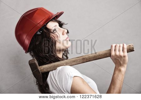 Sex equality and feminism. Sexy girl in safety helmet holding hammer tool. Attractive woman working as construction worker.