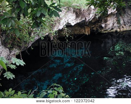 The cave mouth of the Gran Cenote one of the largest natural limestone sinkholes in the Yucatán province of Mexico near Tulum.