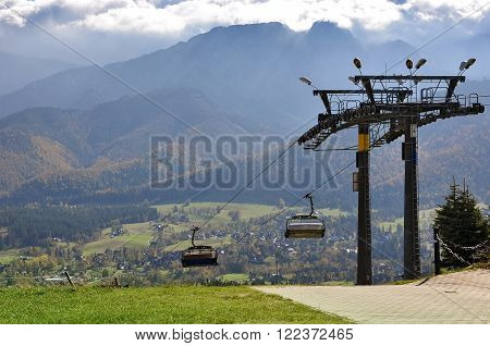 ZAKOPANE, POLAND - OCTOBER 9, 2014: Funicular on the background of the Tatra Mountains in Zakopane, Poland.