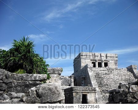 A Mayan pyramid surrounded by coastal jungle in Tulum Yucatán Peninsula Mexico.