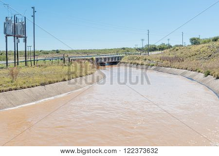SOMERSET EAST SOUTH AFRICA - FEBRUARY 19 2016: Water originating from the Ovis Tunnel in a canal shortly after leaving the Cookhouse tunnel on its way to the Little Fish River
