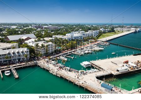 KEY WEST, FL - JULY 11, 2011:  Scenic view of the deep-water cruise port, the Navy vessel port, and Mallory Square.  Cruise ship passengers indulge in the shops and restaurants that Key West is known for.