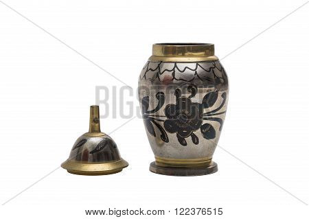 Antic silver engraved dyed metal vase in oriental style with a floral pattern on isolated background