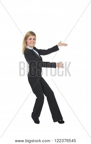 corporate portrait of young attractive and happy business woman posing confident smiling excited presenting product in female presentation and successful businesswoman concept