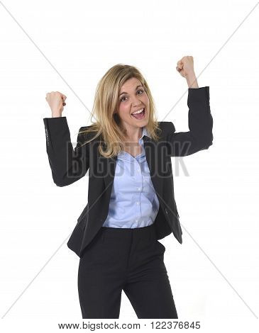 corporate portrait of young attractive and happy business woman with long blond hair posing gesturing with fist excited on career promotion in female success and successful businesswoman