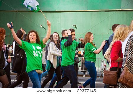 NEW YORK-MARCH 17- Excited and proud New Yorkers march in the St Patrick's Day Parade on March 17 2016 in New York City.