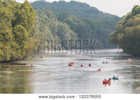 ATLANTA, GA - JULY 2015:  People raft, kayak and canoe down the  Chattahoochee River on a hot summer day in Atlanta, GA on July 25, 2015.