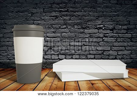 Black coffee cup with white holder and book on wooden surface on black brick background. Mock up 3D Render
